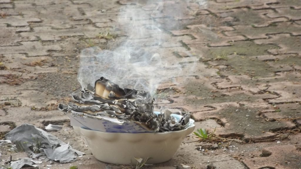 Burning paper in a burn-friendly receptacle