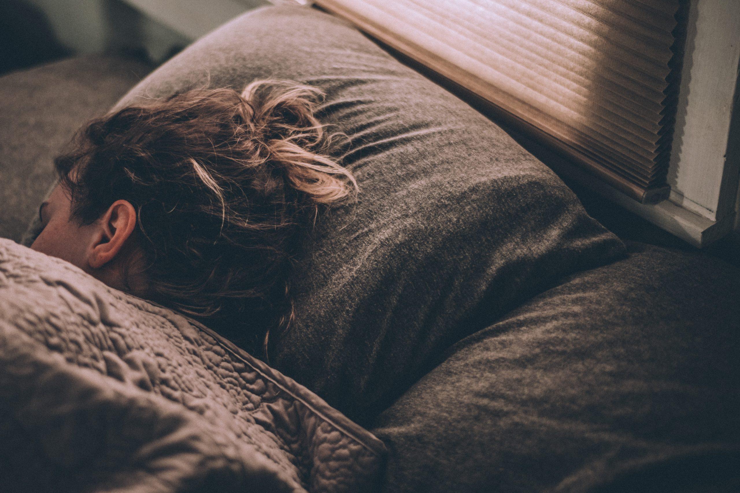 Woman sleeping on grey pillow